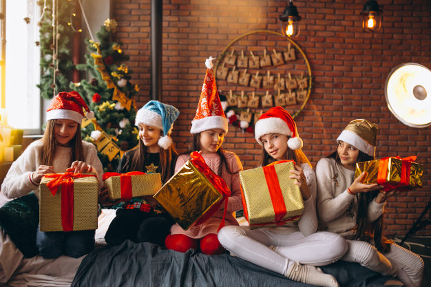 Group of kids sitting sitting with presents