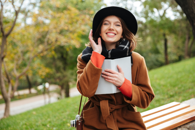 Portrait of a laughing girl dressed in autumn coat